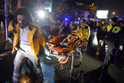Medics carry a wounded person at the scene after an attack at a popular nightclub in Istanbul. Photo / AP