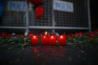 Candles are lit for the victims outside the Turkish nightclub where 39 people were killed. Photo / AP