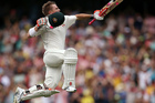 Australia's David Warner jumps in the air to celebrate making 100 runs against Pakistan during their cricket test match in Sydney. Photo/AP Photos