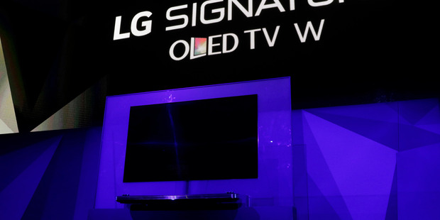 The LG Signature OLED TV W is unveiled during an LG news conference before CES International. Photo / AP