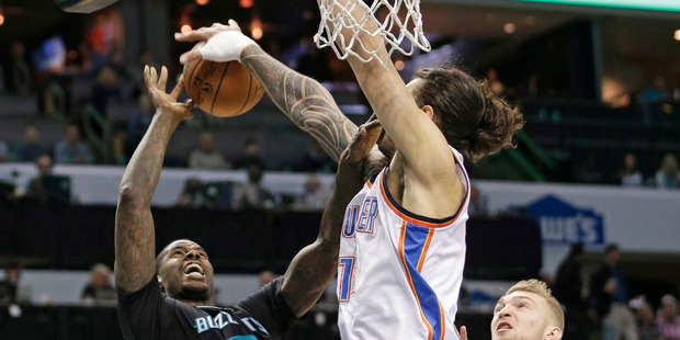 Charlotte Hornets' Marvin Williams (2) has his shot blocked by Oklahoma City Thunder's Steven Adams. Photo/AP Photos