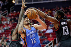 Oklahoma City Thunder's Steven Adams has his shot blocked by Houston Rockets guard James Harden. Photo/AP Photos