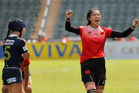 China's Zhao Wenqing, right, celebrates as Japan's Mifuyu Koide walks past at the pool match of the Asia Rugby Sevens Women qualifier. Photo / AP