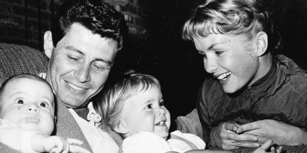 Singer Eddie Fisher, out of the hospital in time for Father's Day, cuddles his two youngsters four-month old Todd, left, and 19-month-old Carrie. Photo / AP