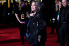 Carrie Fisher was set to have a larger role in Star Wars Episode IX. Here she attends the premiere of the seventh movie in the franchise. Photo/AP