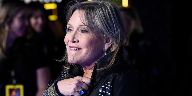 Loading Two volunteers worked on Carrie Fisher for 10 minutes when she had a heart attack on a United flight from London. Photo / AP