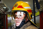 Whanganui senior firefighter Carl Murphy wearing one of the F10 helmets when they were introduced in 2012.  Photo/Bevan Conley