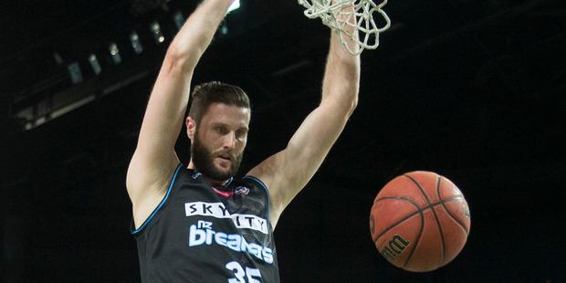 Alex Pledger dunks against the Brisbane Bullets at Auckland's Vector Arena. Photo/NZ Herald