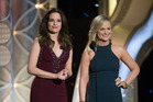 Tina Fey and Amy Poehler hosted the Golden Globes three times and helped make them more popular. Photo/Supplied