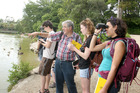 Ornithologist and photographer Peter Frost points out birds of interest to visiting Earlham College students at Virginia Lake. Photo/Bevan Conley