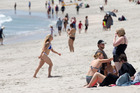MAULER TARGETS: Potential victims of the 'Mount mauler' gather on the beach at Mt Maunganui. Photo / Alan Gibson