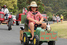 Kendal Wyatt-Logan, 11, won a special prize for pedalling the parade's smallest tractor. Photo / Peter de Graaf