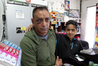 Battered shopkeeper Paramjit Singh and son Gurnarbhey, 11, at the Duke Street Food Mart yesterday, the day after Mr Singh was assaulted by a customer. PHOTO/PAUL TAYLOR