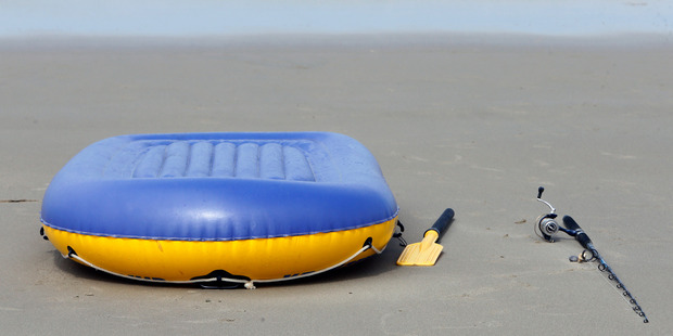 The toy-like inflatable dinghy and paddle used by the crab fisher. Photo / John Stone
