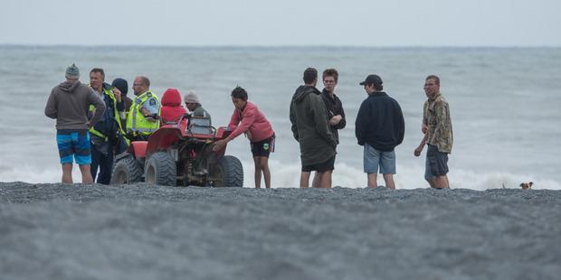 Searchers at Onoke spit. Photo / Wairarapa Times-Age
