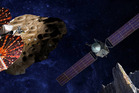 An artist's conception shows the Lucy spacecraft flying by the Trojan Eurybates. At right the Psyche orbiter will map the massive asteroid belt object 16 Psyche. Image / SwRI and SSL/Peter Rubin.