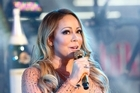 Mariah Carey performs at the New Year's Eve celebration in Times Square . Photo/AP