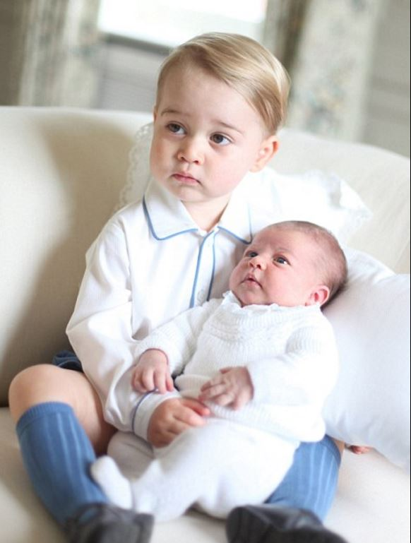 Prince George holding Princess Charlotte at their home in Anmer Hall, Norfolk, in May 2015. Photo / Supplied