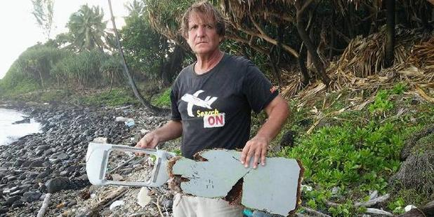 Independent MH370 investigator Blaine Alan Gibson with debris discovered on Riake Beach, Madagascar. Photo / Facebook