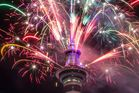Fireworks bring in the new year at the Sky Tower in Auckland. Photo / Peter Meecham