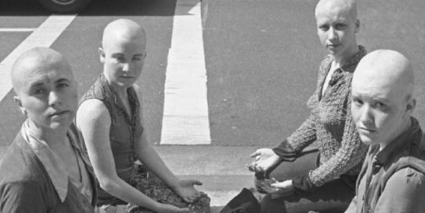 Members of the Manson Family sat with shaved heads outside the courthouse where their leader was being tried for multiple murder. Photo / AP
