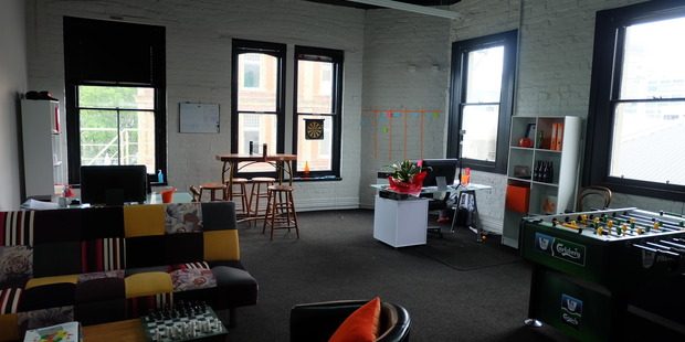 Inside Crew Consulting's Dowling Street office, featuring a foosball table.