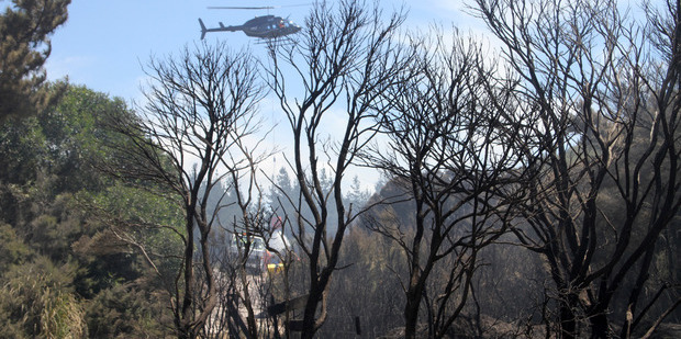 A helicopter fights a fire at Matai Bay, in the Far North, this week, one of many that has triggered a warning that those starting fires will be billed for the costs and possibly prosecuted.