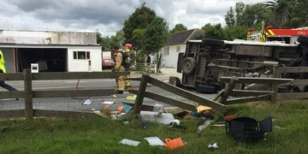 Firefighters at the scene of a crash between a car and a campervan which injured seven people, including two young children. Photo / Supplied