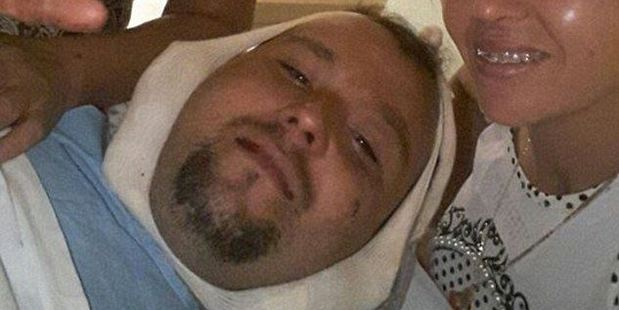 A post-surgery photo shared by a friend showing the injured man offering a smile. Photo / Facebook