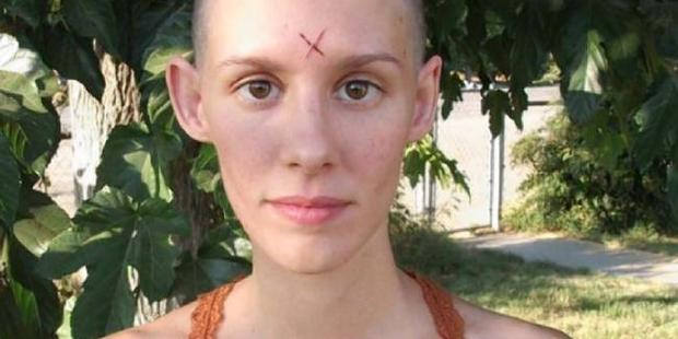 Loading Charles Manson's fiancee Afton Elaine Burton, who calls herself Star, has scratched a cross into her forehead. Photo / Manson Direct
