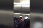 """Footage supplied.   No charges are to be laid against the American passenger whose allegedly verbally aggressive, racist behavior ended with the New Year's Day San Francisco-bound flight diverted to Auckland.   Passengers recounted the man allegedly going into a """"racist"""" rant towards two passengers who'd been seated on either side of him on the United Airlines flight."""