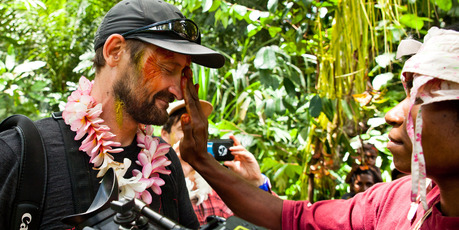 Mike Scott is welcomed into the village of Boroi with traditional 'facepainting'. Photo / Simon Day