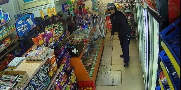 One of the men wanted after a daylight robbery at a South Auckland dairy. Photograph supplied by New Zealand Police