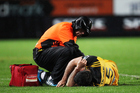 Hurricanes' fullback Nehe Milner-Skudder gets treatment from a physio who looks like Darth Vader. Photo / Photosport
