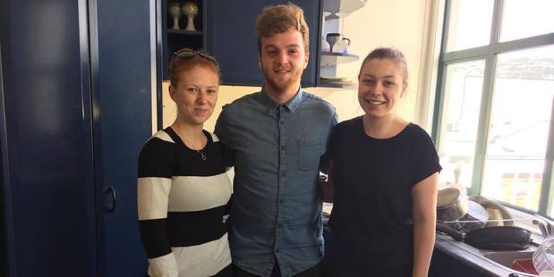 Brittany Godderidge (left), Toby Jones, and Hayley Salmon are reunited after being evacuated from their central Wellington apartment in November. Photo/Melissa Nightingale