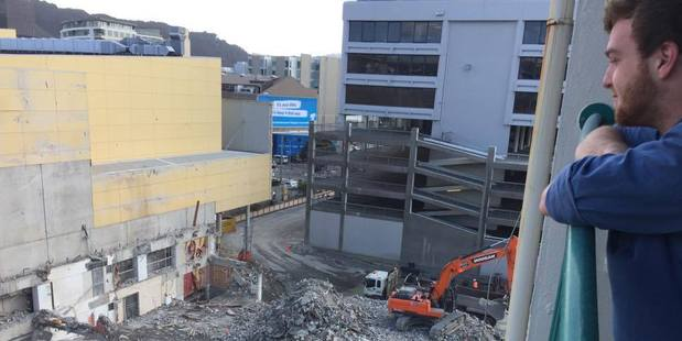 Toby Jones checks out the new view of the Reading Cinema car park demolition site from his central Wellington apartment. Photo/Melissa Nightingale