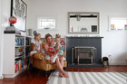 23 Eversleigh Rd, Takapuna, with Fiona Smith and her daughters, twins Zoe and Scarlett and Greta, 2. Photo / Fiona Goodall / Getty Images