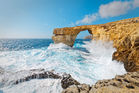 The Azure Window in stormy weather. It collapsed into the sea today. Photo / 123RF