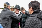 Drew Carson, 18, didn't run out of hugs after winning the Young Rider of the Year crown yesterday. In the background is her father, Vance (brown cap). PHOTO/Paul Taylor