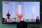 TV news on North Korea's missile launch in February. Photo / AP