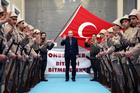 Young supporters in old military uniforms greet Turkey's President Recep Tayyip Erdogan at a meeting in Istanbul. Photo / AP