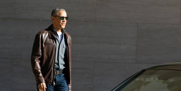 Former President Barack Obama leaves the National Gallery of Art in Washington today. President Donald Trump has accused Obama of tapping his phones at Trump Tower. Photo / AP