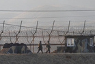 South Korean army soldiers patrol along the barbed-wire fence in Paju, South Korea, near the border with North Korea. Photo / AP