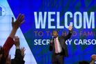 Housing and Urban Development Secretary Ben Carson asks people to raise their hands as he speaks to HUD employees in Washington. Photo / AP