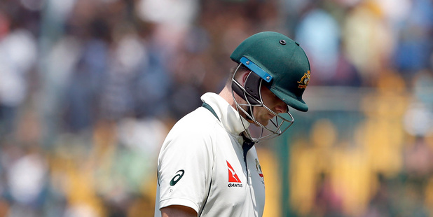 Australia's captain Steven Smith leaves the field after being dismissed. Photo / AP