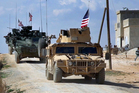 US troops are making their presence known in Syria, including around the town of Manbij. Photo / AP