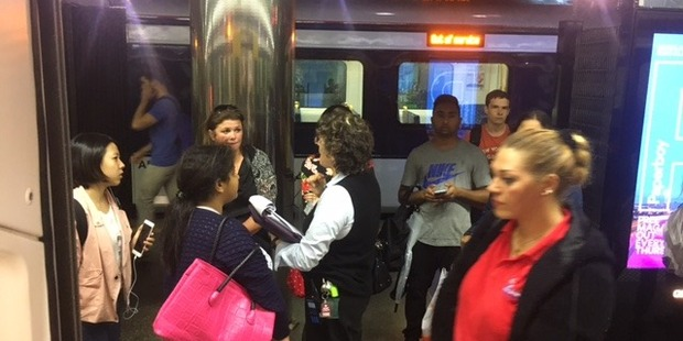 Passengers stuck outside the train as weather chaos hits again. Photo / Supplied