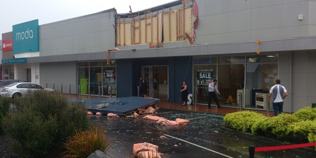 "There's talk a ""mini tornado"" ripped this Auckland homeware store's sign off its shop front overnight. Photo/ James Stature"