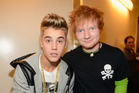 Ed Sheeran accidently hit Justin Bieber with a golf club in Japan. Photo / Getty