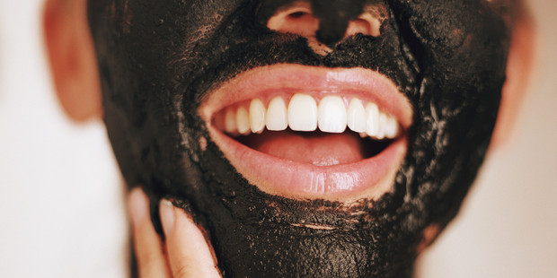 Activated charcoal absorbs environmental toxins from deep within the pores. Photo / Getty Images